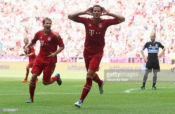 Daniel van Buyten and Holger Badstuber of Bayern Muenchen celebrate van Buyten's first goal during the Bundesliga match between FC Bayern Muenchen...
