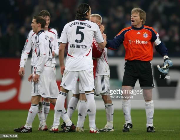 Daniel van Buyten and Olive Kahn of Bayern celebrate the 10 victory after the Bundesliga match between Schalke 04 and Bayern Munich at the Veltins...