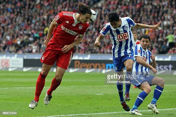 Daniel van Buyten of Bayern and Cicero of Berlin go up for a header during the Bundesliga match between Hertha BSC Berlin and FC Bayern Muenchen at...