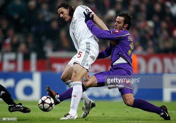 Daniel van Buyten of Bayern is challenged by Alberto Gilardino of Florence during the UEFA Champions League round of sixteen, first leg match between...