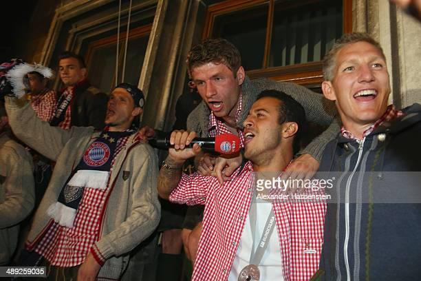 Daniel van Buyten of Bayern Muenchen and his team mates Thiago Alcantara and Bastian Schweinstieger e celebrate winning the German championship title...