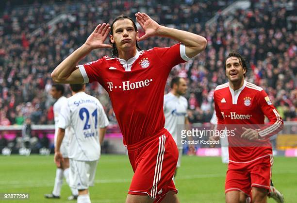 Daniel van Buyten of Bayern Muenchen celebrates after scoring the opening goal during the Bundesliga match between FC Bayern Muenchen and FC Schalke...