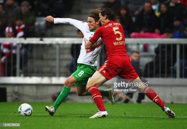 Daniel van Buyten of Bayern Muenchen fights for the ball with Clemens Fritz of Werder Bremen during the Bundesliga match between FC Bayern Muenchen...