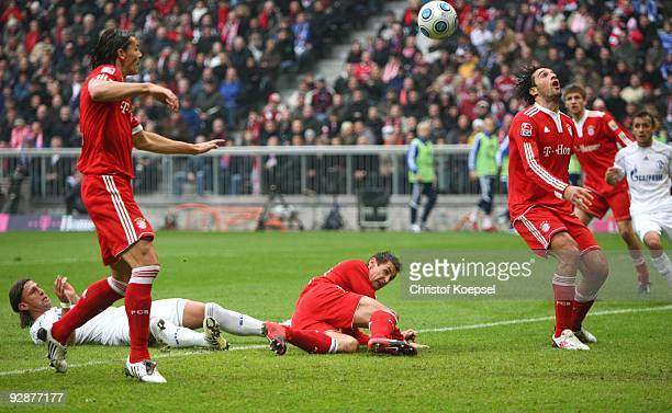 Daniel van Buyten of Bayern Muenchen scores the opening goal during the Bundesliga match between FC Bayern Muenchen and FC Schalke 04 at Allianz...
