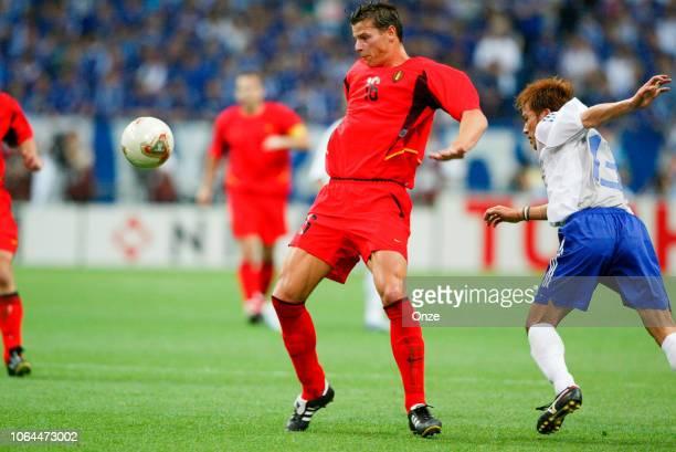 Daniel Van Buyten of Belgium and Atsushi Yanagisawa of Japan during the World Cup match between Japan and Belgium in Saitama Stadium in Saitama Japan...