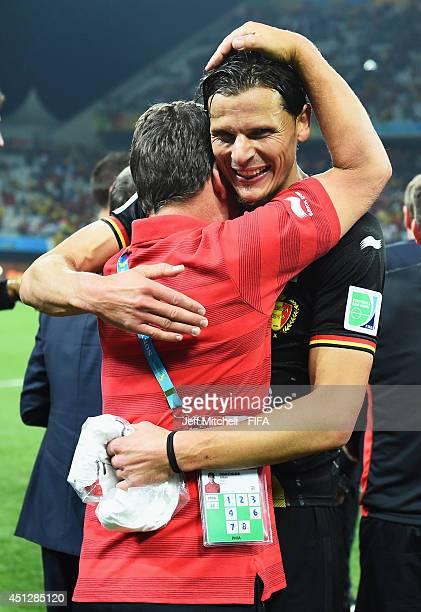 Daniel Van Buyten of Belgium celebrates the 1-0 win with team staff Johan Demecheleer after the 2014 FIFA World Cup Brazil Group H match between...