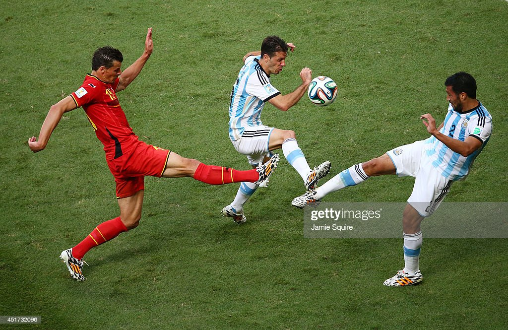 Daniel Van Buyten of Belgium competes for the ball with Martin Demichelis (C) and Ezequiel Garay of Argentina during the 2014 FIFA World Cup Brazil Quarter Final match between Argentina and Belgium at Estadio Nacional on July 5, 2014 in Brasilia, Brazil.