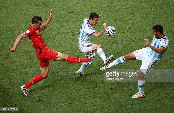 Daniel Van Buyten of Belgium competes for the ball with Martin Demichelis and Ezequiel Garay of Argentina during the 2014 FIFA World Cup Brazil...