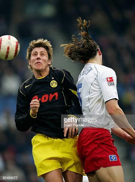Daniel Van Buyten of Hamburg in action against Markus Brzenska of Dortmund during The Bundesliga Match between Hamburg SV and Borussia Dortmund at...
