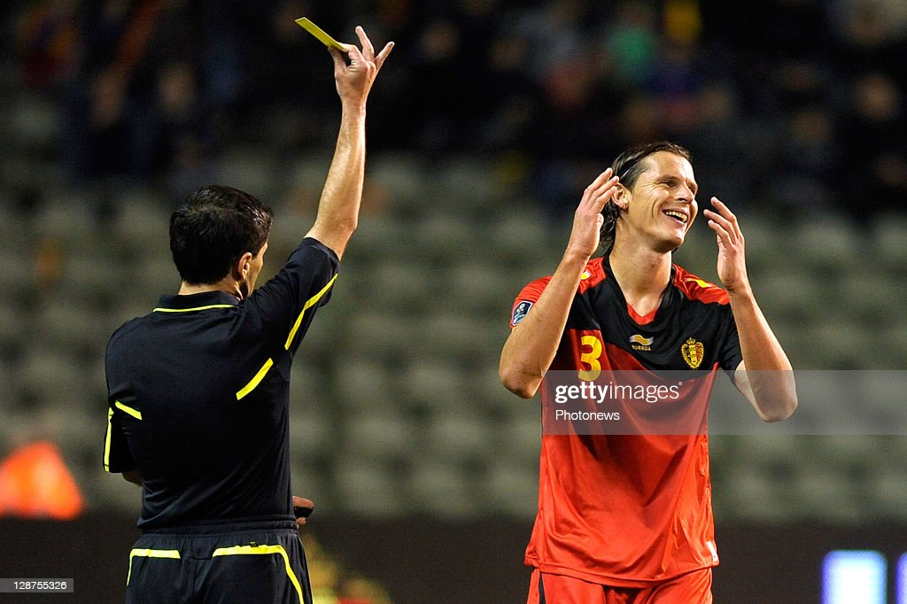 Daniel Van Buyten reacts as he receives a yellow card from referee Milorad Mazic during the UEFA EURO 2012 Group A qualifying match between Belgium and Kazakhstan at King Baudouin Stadium on October 7, 2011 in Brussels, Belgium.