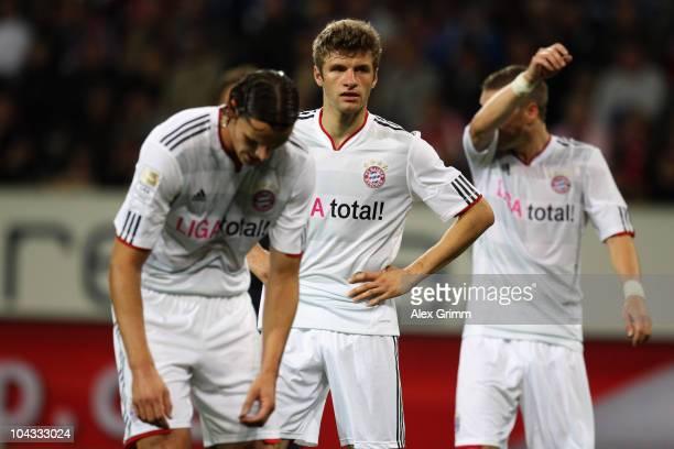 Daniel van Buyten Thomas Mueller and Bastian Schweinsteiger of Muenchen react during the Bundesliga match between 1899 Hoffenheim and FC Bayern...