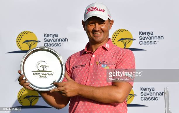 Daniel van Tonder of South Africa poses with the trophy during Day Four of the Kenya Savannah Classic at Karen Country Club on March 26, 2021 in...