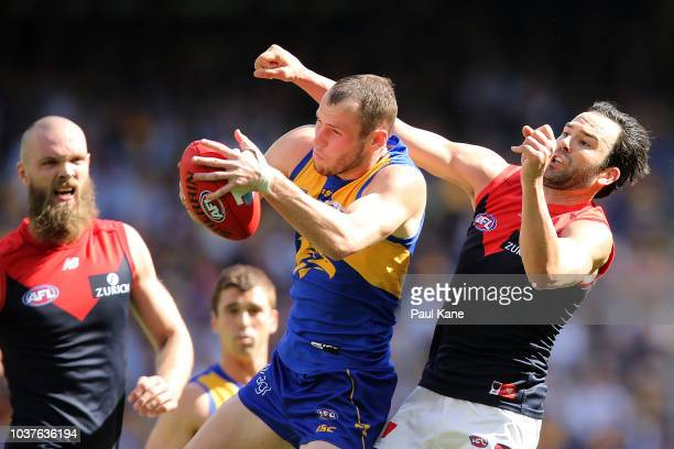 Daniel Venables of the Eagles marks the ball against Jordan Lewis of the Demonsduring the AFL Preliminary Final match between the West Coast Eagles...