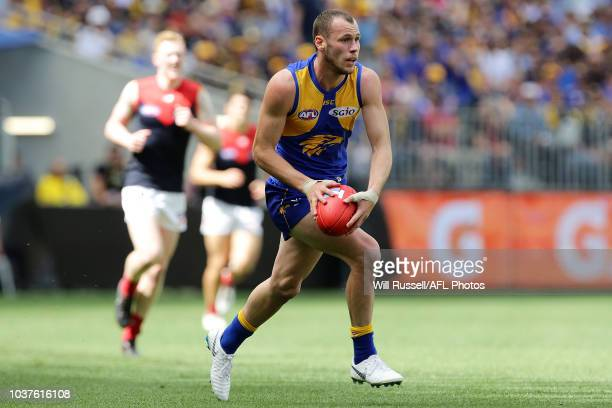 Daniel Venables of the Eagles runs with the ball during the AFL Prelimary Final match between the West Coast Eagles and the Melbourne Demons on...