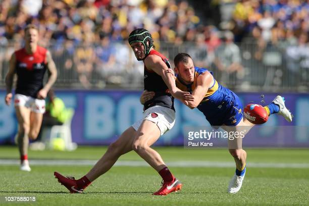 Daniel Venables of the Eagles tackles Angus Brayshaw of the Demons during the AFL Preliminary Final match between the West Coast Eagles and the...