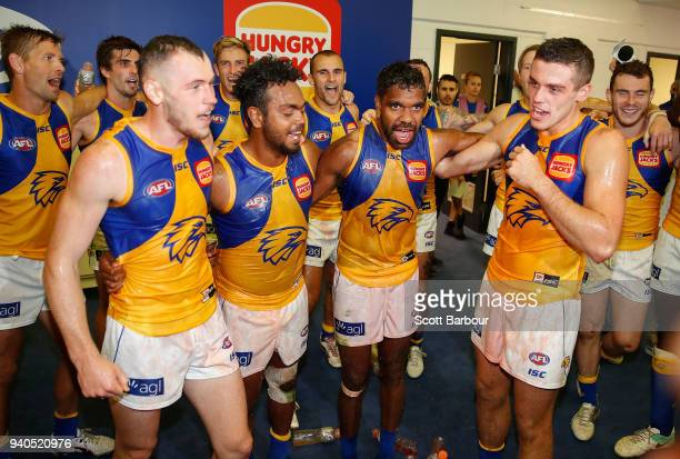 Daniel Venables Willie Rioli Liam Ryan and Jake Waterman of the Eagles sing the team song their first win during the round two AFL match between the...