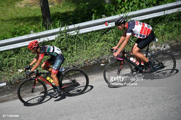 Daniel Ver Carino of 7 Eleven Roadbike Philippines leads to Niels Van Der Pijl of Netherlands and PCS Team Procyclingstatscom during stage 5 of the...