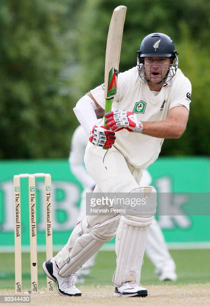Daniel Vettori of New Zealand drives the ball away for four runs during day one of the First Test match between New Zealand and Pakistan at...