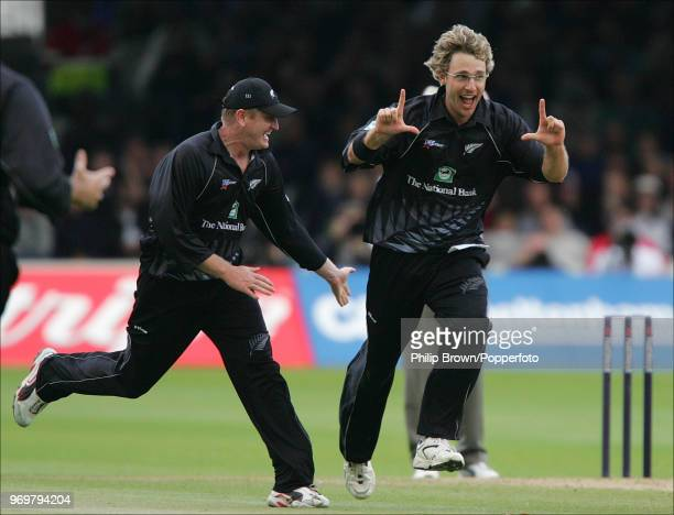 Daniel Vettori of New Zealand is congratulated by teammate Scott Styris after taking the wicket of West Indies captain Brian Lara during the Natwest...