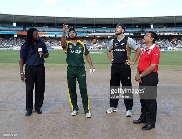 Daniel Vettori of New Zealand looks on as Shahid Afridi tosses the coin before The ICC World Twenty20 Super Eight mMatch between New Zealand and...