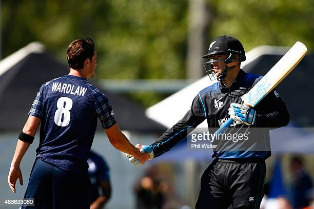 Daniel Vettori of New Zealand shakes hands with Iain Wardlaw of Scotland after hitting the winning runs during the ICC Cricket World Cup match...