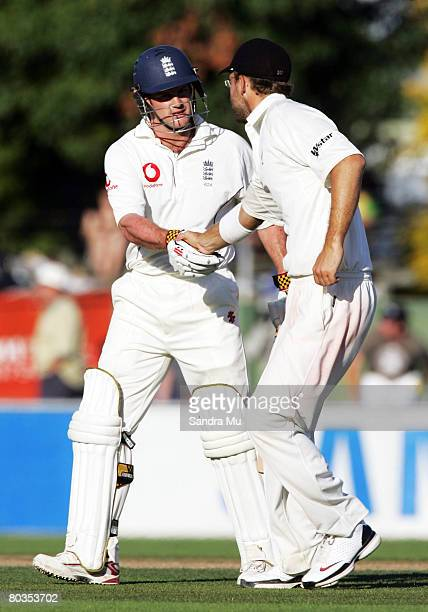Daniel Vettori of New Zealand shakes the hand of Andrew Strauss of England at the end of play during day three of the Third Test match between New...