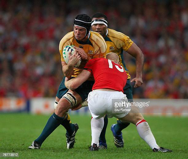 Daniel Vickerman of Australia attempts to break the tackle of Tom Shanklin of Wales during the Rugby World Cup 2007 Pool B match between Wales and...