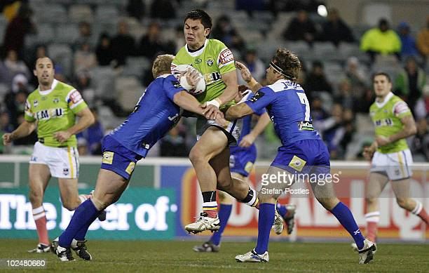 Daniel Vidot of the Raiders is tackled during the round 16 NRL match between the Canberra Raiders and the Canterbury Bulldogs at Canberra Stadium on...