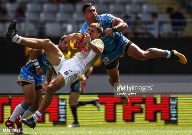 Daniel Vidot of the Titans and Jed Cartwright of the Panthers compete for a high ball during the 2017 Auckland Nines match between the Penrith...