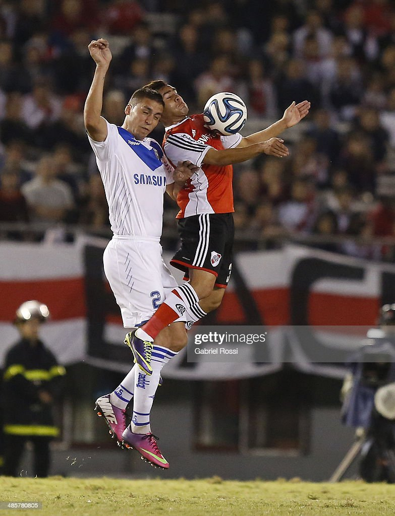Daniel Villalba of River Plate fights for the ball with Fernando Tobio of Velez Sarsfield during a match between River Plate and Velez Sarsfield as part of 15th round of Torneo Final 2014 at Monumental Antonio Vespucio Liberti Stadium on April 12, 2014 in Buenos Aires, Argentina.