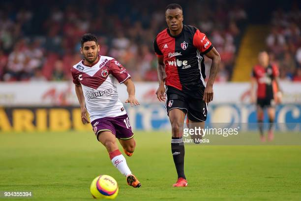 Daniel Villalva of Veracruz and Jaine Barreiro of Atlas compete for the ball during the 12th round match between Veracruz and Atlas as part of the...