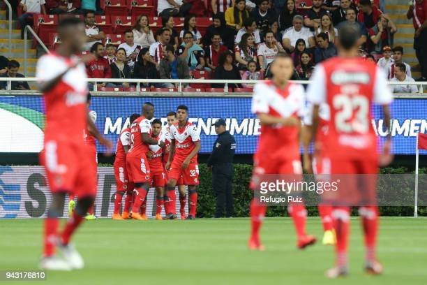 Daniel Villalva of Veracruz celebrates with his teammates after scoring the first goal of his team during the 14th round match between Chivas and...