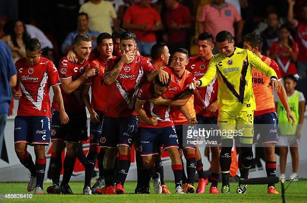 Daniel Villalva of Veracruz celebrates with teammates after scoring the second goal of his team during a 7th round match between Veracruz and...