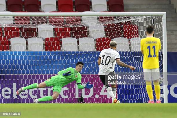 Daniel Vlad of Romania dives for the ball as Lukas Nmecha of Germany hits the post from the penalty spot during the 2021 UEFA European Under-21...