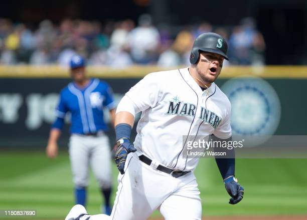 Daniel Vogelbach of the Seattle Mariners celebrates his home run as he rounds third base in the first inning against the Kansas City Royals at...