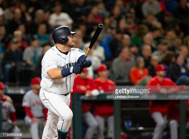 Daniel Vogelbach of the Seattle Mariners watches his solo home run in the eighth inning against the Los Angeles Angels of Anaheim at TMobile Park on...
