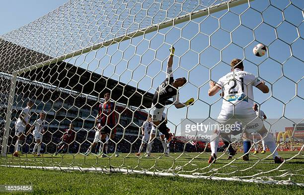 Daniel Vukovic goalkeeper of the Glory dives to save a goal during the round two ALeague match between the Newcastle Jets and the Perth Glory at...