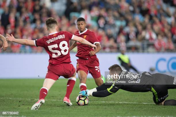 Daniel Vukovic of Sydney FC dives on a loose ball during the International Friendly match between Sydney FC and Liverpool FC at ANZ Stadium on May 24...