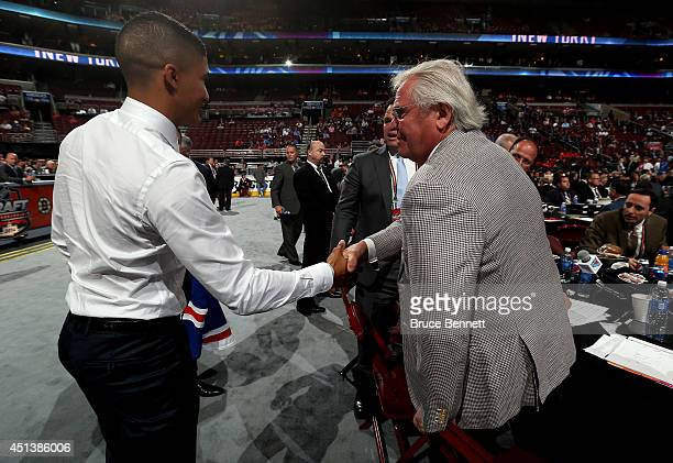 Daniel Walcott meets Glen Sather after being drafted by the New York Rangers on Day Two of the 2014 NHL Draft at the Wells Fargo Center on June 28...