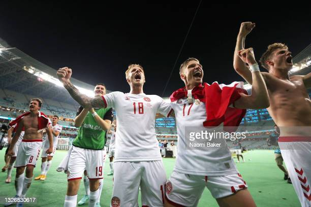 Daniel Wass and Jens Stryger Larsen of Denmark celebrates their side's victory after the UEFA Euro 2020 Championship Quarter-final match between...