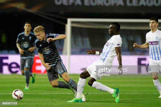 Daniel Wass midfielder of Celta de Vigo battles for the ball with Omar Colley defender of KRC Genk FC during the UEFA Europe League Round of 4 first...