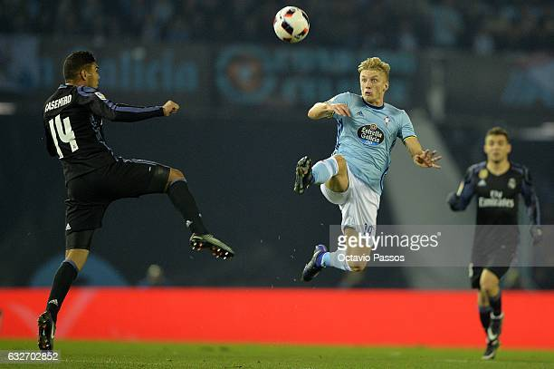 Daniel Wass of Celta de Vigo competes for the ball with Casemiro of Real Madrid during the Copa del Rey quarterfinal second leg match between Real...