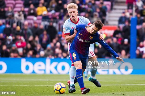Daniel Wass of Celta de Vigo fouls Denis Suarez of FC Barcelona during the La Liga match between FC Barcelona and Celta de Vigo at Camp Nou on...