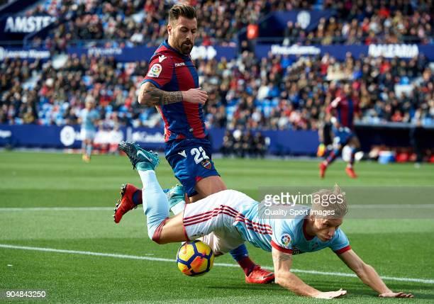 Daniel Wass of Celta de Vigo is tackled by Antonio Luna of Levante during the La Liga match between Levante and Celta de Vigo at Ciutat de Valencia...