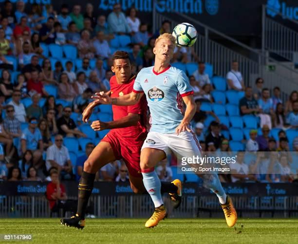 Daniel Wass of Celta de Vigo wins a header during the preseason friendly match between Celta de Vigo and AS Roma at Balaidos Stadium on August 13...