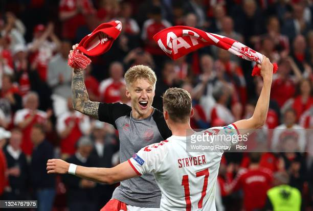 Daniel Wass of Denmark celebrates with teammate Jens Stryger Larsen after victory in the UEFA Euro 2020 Championship Group B match between Russia and...