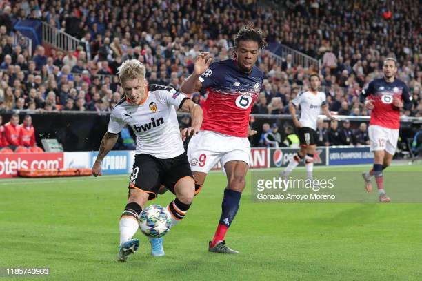 Daniel Wass of Valencia battles for possession with Loic Remy of Lille during the UEFA Champions League group H match between Valencia CF and Lille...