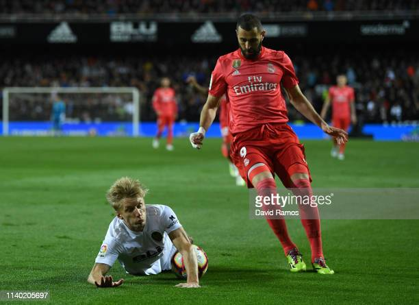Daniel Wass of Valencia battles for the ball with Karim Benzema of Real Madrid during the La Liga match between Valencia CF and Real Madrid CF at...