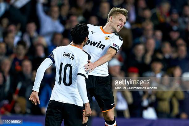 Daniel Wass of Valencia celebrates after scoring his team's second goal with his teammate Dani Parejo during the UEFA Champions League group H match...