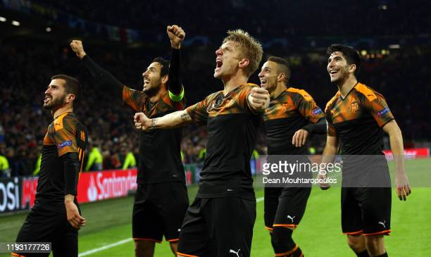 Daniel Wass of Valencia celebrates victory with team mates during the UEFA Champions League group H match between AFC Ajax and Valencia CF at...